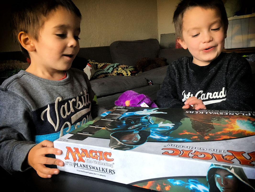 Twin boys playing Magic: Arena of the Planeswalkers. So excited!
